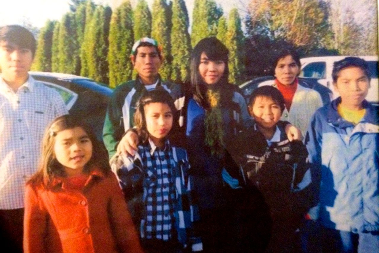 Ciin Nuam, second from left, and her family in November. Nuam, a Burmese refugee, died suddenly Dec. 2, 2014, leaving behind her husband and seven children. Courtesy Zam Khup.