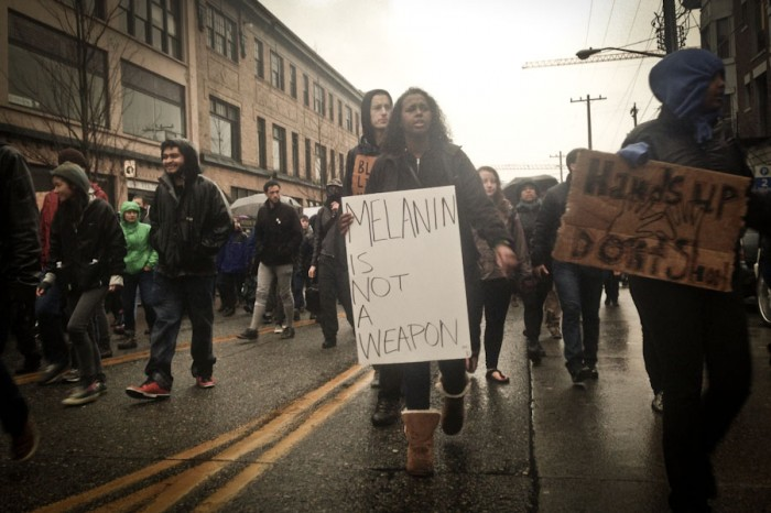 Protestors march up Pike Street toward the Comet Tavern during a Black Friday march responding to the Ferguson grand jury decision. (Photo by Sarah Stuteville)