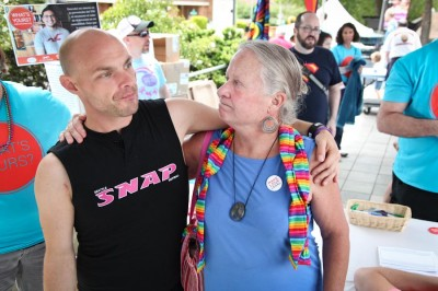 Carol Glenn (right) reunites with Tye Garsen, a volunteer for the Gay City Health Project, at Seattle PrideFest 2014. Glenn's work as a nurse during the height of the AIDS crisis led her to forge strong bonds in the LGBT community. (Photo by Alex Stonehill)