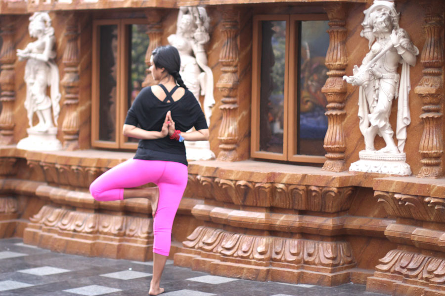 The author, Sweta Saraogi, practices yoga at a temple India. (Courtesy photo)