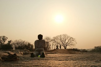 Hey, where's his lululemons? An Indian man practices yoga at dawn near Bangalore (Photo by Vinoth Chandar)