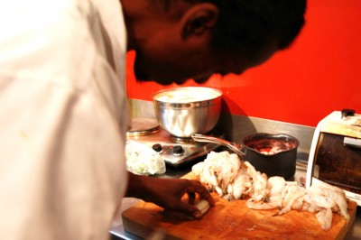 Tarik Abdullah preps for one of his Hillman City pop-up dinners. (Photo courtesy of Tarik Abdullah)