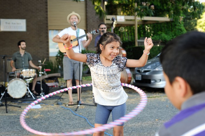 Neighbors get down at the Holly Street Night Out event last year. (Photo by Colleen McDevitt)