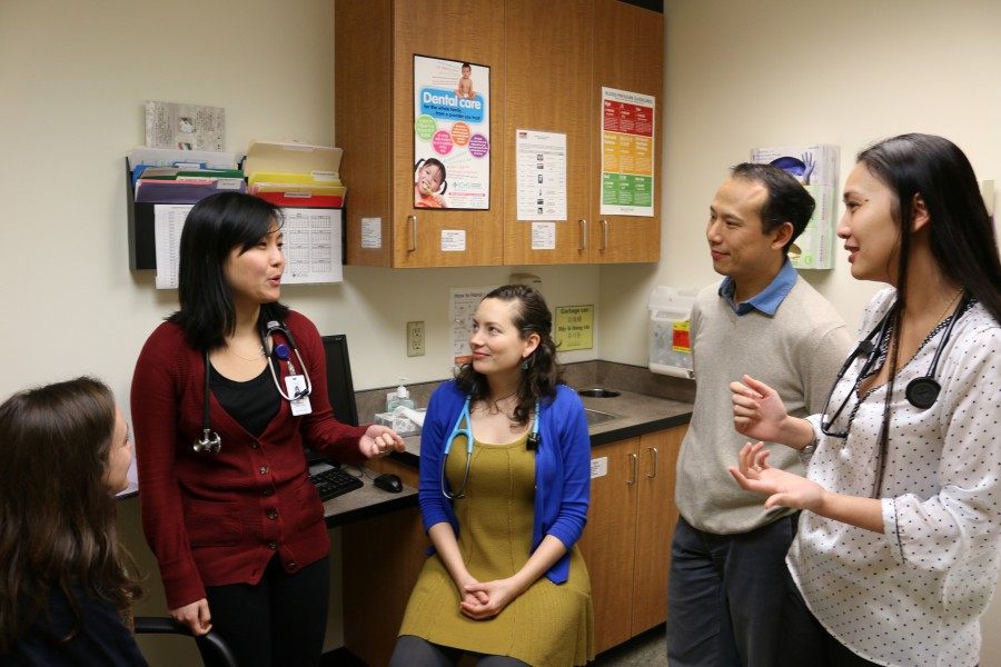 DoQuyen Huynh, DNP-FNP, (right) ICHS ARNP Residency Program Administrator, conducts a briefing on clinical work assignments and issues with program residents (from left) Jean Baumgardner, Kimberly Lee-Cooper, Megan Wilbert, and the program's deputy administrator, Chris Yee, M.D. (Photo courtesy International Community Health Services)