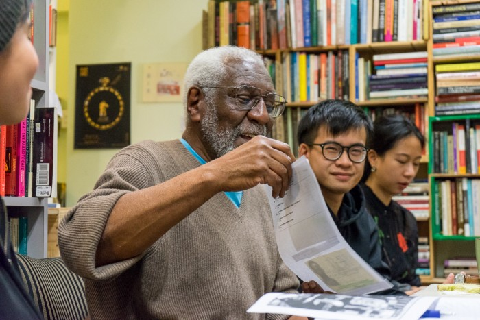 Cook speaks with activists inside a Hong Kong bookstore during one of his talks. (Photo by Chong Kai Xiong)