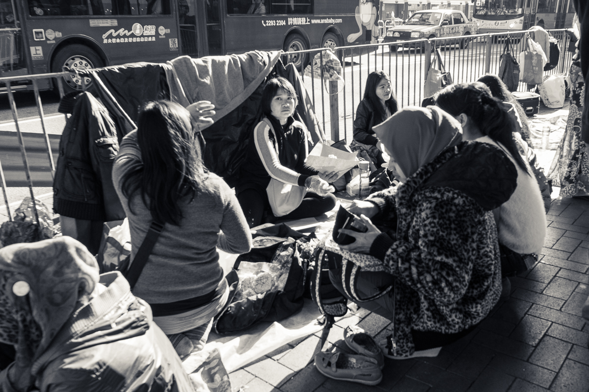 Migrant domestic workers lay low on a Sunday afternoon at Victoria Park. Sundays are their only day off in Hong Kong. (Photo by Chong Kai Xiong)