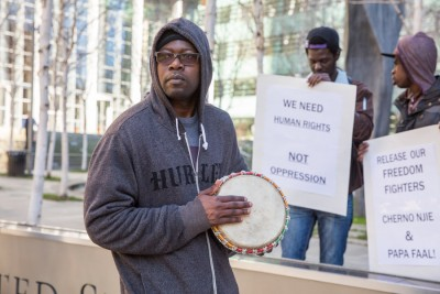 Ousman Ceesay, a Gambian American living in Seattle, turned out to show his support for two American citizens charged with trying to overthrow Gambia's dictatorship. (Photo by Alex Garland)