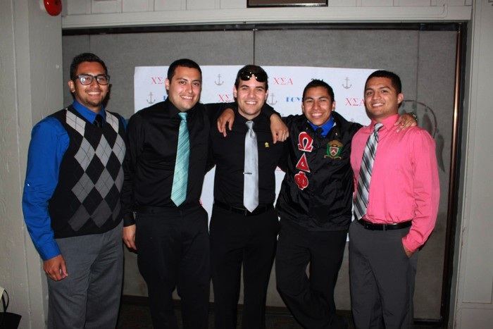 Drew Largé, center, with members of his Hispanic fraternity. (Photo by Kyle Jensen)