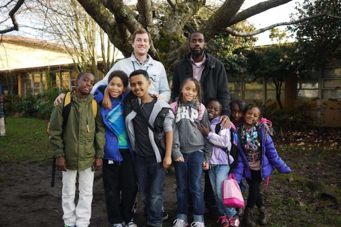 Kristopher Green (back right) with a group of Graham Hill elementary school students who he began walking home this school year after the district cut their bus service. (Courtesy photo)