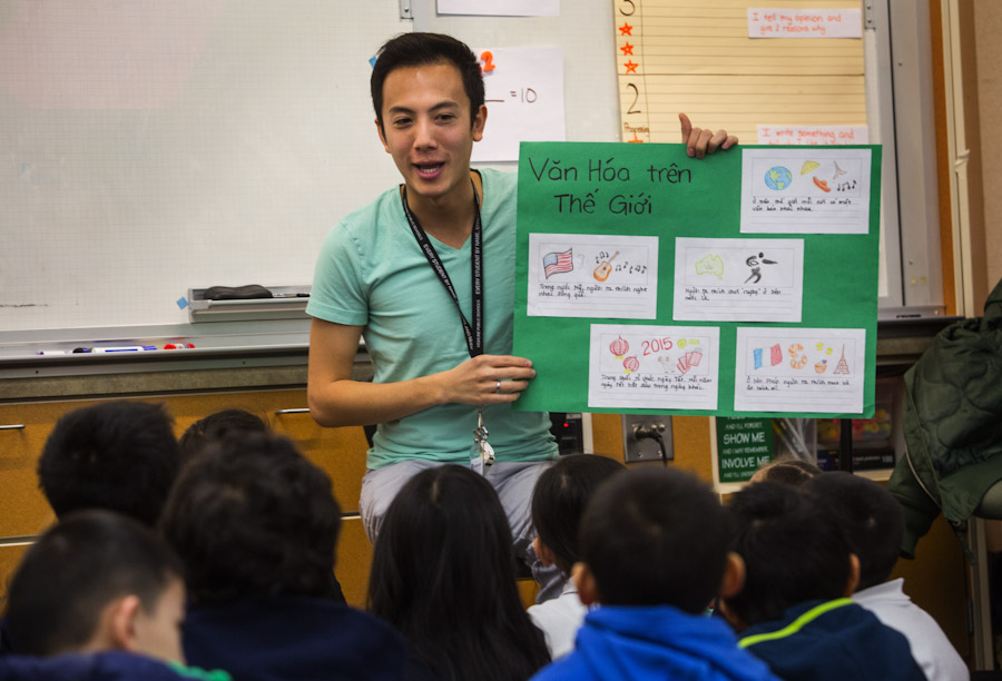 Tu Thanh Dinh, a first grade teacher at White Center Heights Elementary in Burien, leads a lesson to his first grade students in their Vietnamese immersion language class. (Photo by Ellen Banner / The Seattle Times)