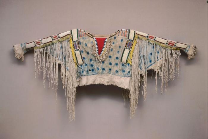 Man's shirt, ca. 1850, Niimiipu (Nez Perce), Oregon or Idaho, Hide, porcupine quills, horsehair, wool, glass beads, pigment, 32 11/16 × 60 2/3 in., Diker no. 666 Courtesy of American Federation of Arts