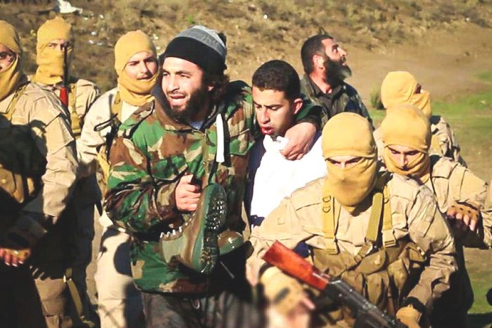 A video released by ISIS shows Jordanian pilot Muath al-Kasesbeh captured after his plane crashed in a lake near Raqqa, Syria in early January.