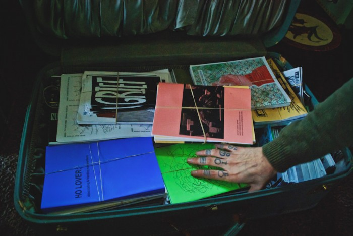 The modest suitcase that houses the Brown Recluse Zine Distro's library. (Photo by Atoosa Moinzadeh)