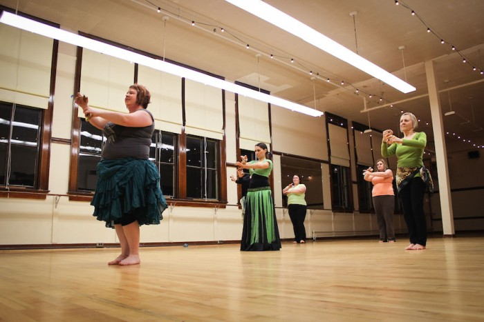 Moore and her students in a beginning level belly dancing class in Seattle. (Photo by Dominique Etzel)