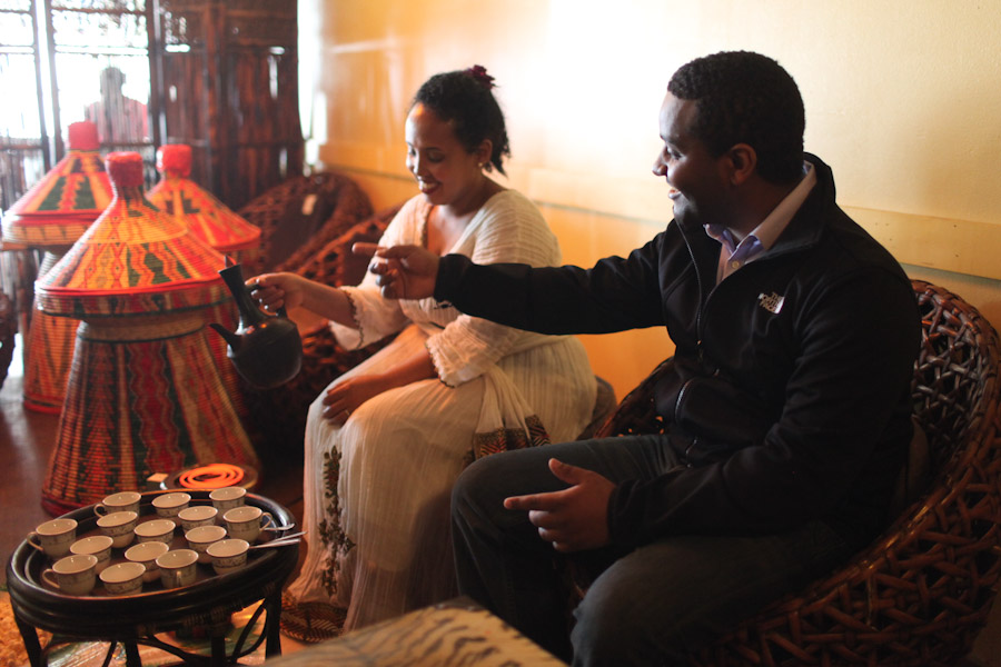 Amen Gibreab (right), director of the film Horeta: The Journey Beyond Culture, enjoys a traditional Ethiopian coffee ceremony performed by Fanaye Debalke at Gojo Ethiopian Restaurant on Aurora Ave. (Photo by Alex Stonehill)