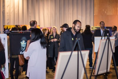 """Visitors take in the """"Through the Eyes of Art"""" showcase. (Photo by Jama Abdirahman)"""