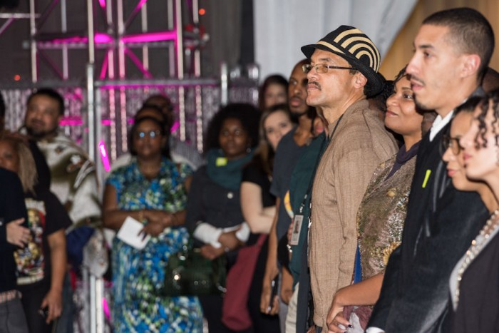 Event attendees listen to Derrick Wheeler-Smith's speech on racism, the value of black life, and police brutality. (Photo by Jama Abdirahman)