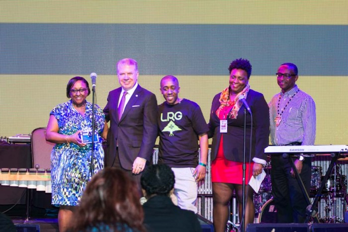 Draze, Mayor Ed Murray and others on stage for the creation of a time capsule honoring the Seattle hip hop scene. (Photo by Jama Abdirahman)