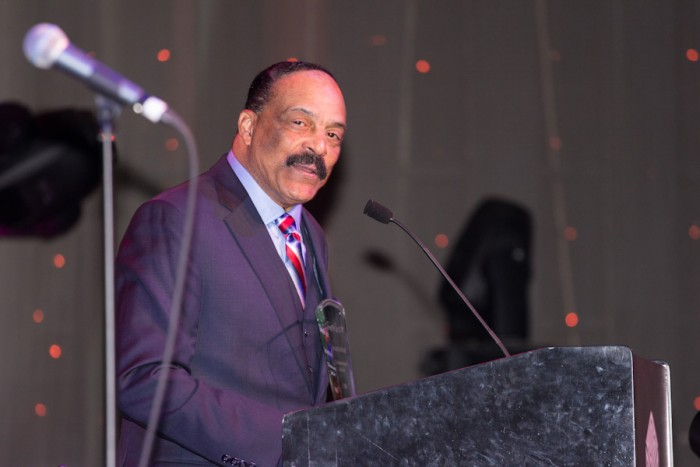 """Activist Eddie Rye, Jr, who was instrumental in the renaming of Seattle's Empire Way to Honor Martin Luther King, Jr in the early 1980's, receives an award as """"Servant of the People."""" (Photo by Jama Abdirahman)"""