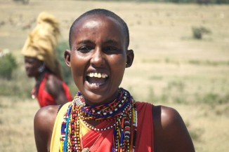 A young Maasai woman with her head shaved — part of many rites of passage in Maasai culture. (Photo from Flickr by Javier Carcamo)