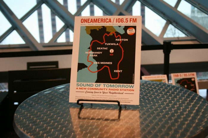 At the Seattle Public Library, each of the 13 stations in the Puget Sound Radio Cohort displayed the radius of their reach. Above, the radius for OneAmerica. (Photo courtesy Brown Paper Tickets).