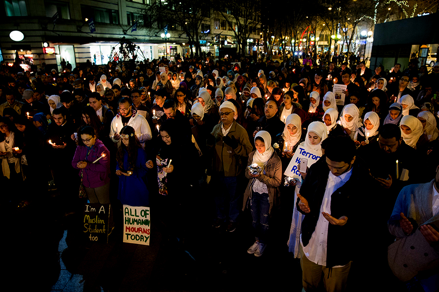 Hundreds join in a Muslim prayer at the beginning of Seattle's vigil in Westlake Park in honor of three Muslim students who were killed in a shooting in Chapel Hill in February. (Photo by Alex Garland.)