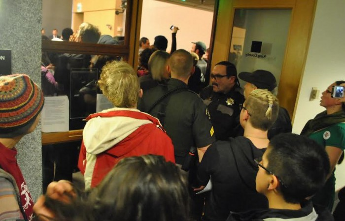 A crowd packed a King County Council meeting to object to a new youth jail. (Photo courtesy South Seattle Emerald.)