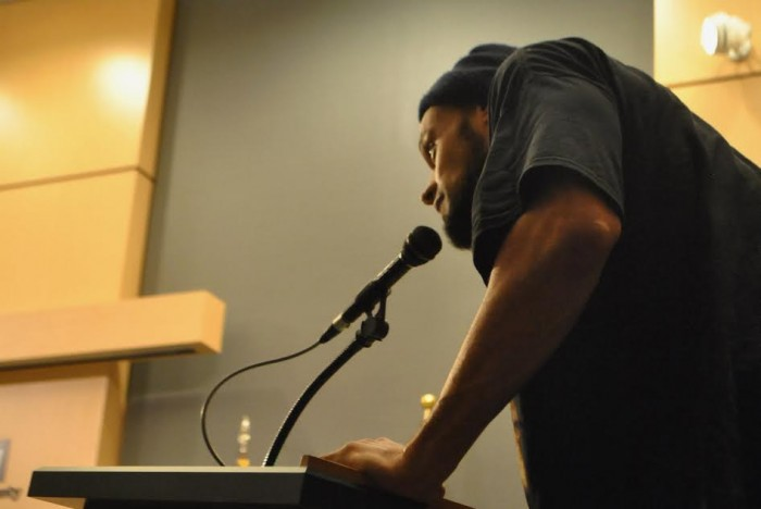 Afam Ayika addresses King County Council. (Photo by Celia Berk for the South Seattle Emerald)