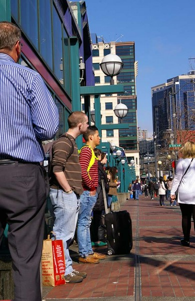Passengers wait in line for a BoltBus to Portland outside of the International Station in Seattle (Photo by Holly Thorpe)