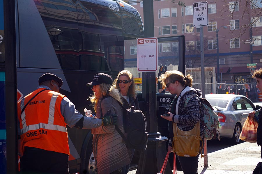 A BoltBus driver loads luggage into the bottom of a bus in Seattle. (Photo by Holly Thorpe)