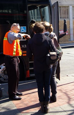 Passengers have their tickets scanned for a BoltBus to Portland outside of the International Station in Seattle (Photo by Holly Thorpe)