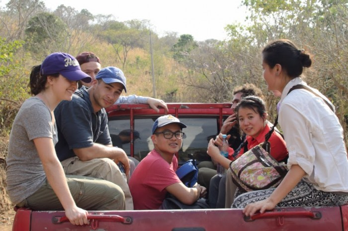 Task force students, including the author pictured in the purple hat, take a ride in the back of a pick-up truck while traveling through the countryside. (Photo Courtesy of Unfinished Sentences)
