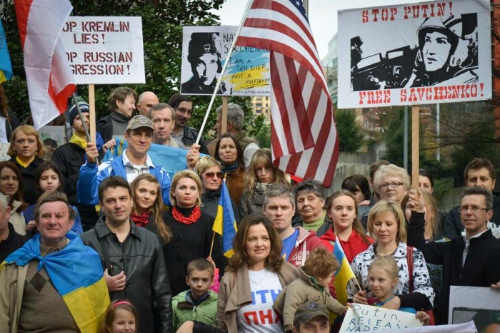 "Ukrainians, Russians, and Americans standing together for ""Seattle in memory of Boris Nemtsov and support of Nadejda Savchenko,"" a rally organized by Seattle-based Russian-Americans and UAWS. (Courtesy photo)"