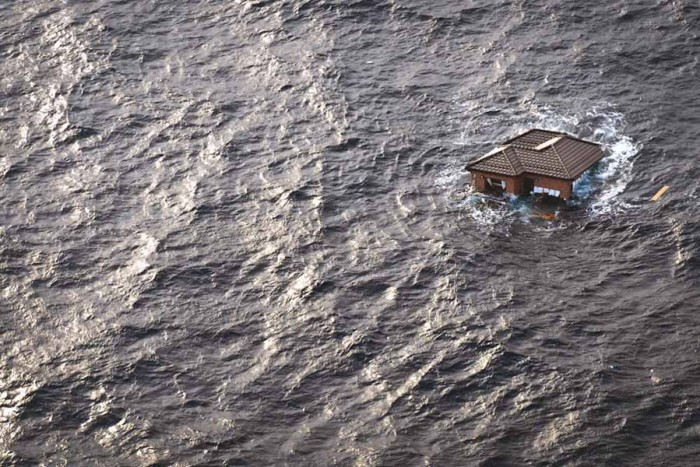 A house flooded by the 2011 Tōhoku earthquake and tsunami. (Photo from flickr by Douglas Sprott)