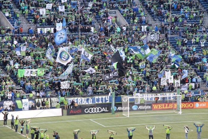 The Emerald City Supporters wave their flag and cheer loudly before the match. (Photo by Justice Magraw)