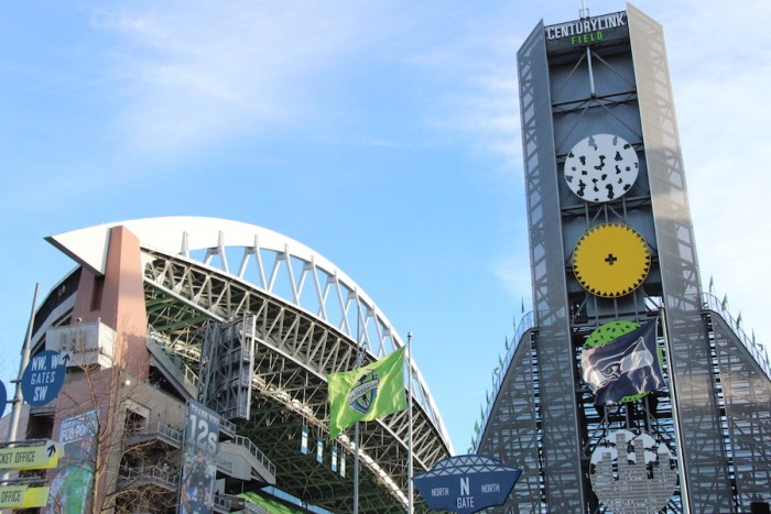 The Sounders FC flag and Seahawks flag wave on the North side of CenturyLink Field. (Photo by Justice Magraw)