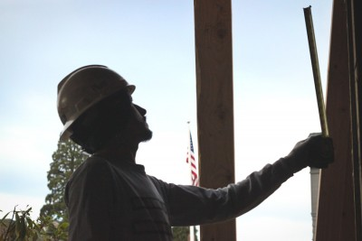 A Mexican construction worker building a new home in Magnolia. Employer James Watanabe says most of his company's Mexican workers eventually return home. (Photo by Alysa Hullett)