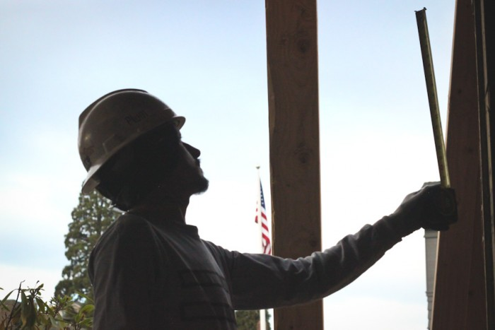 An immigrant construction worker building a new home in Seattle's Magnolia neighborhood. Employer James Watanabe says most of his company's Mexican workers eventually return home, usually without much notice. (Photo by Alysa Hullett)