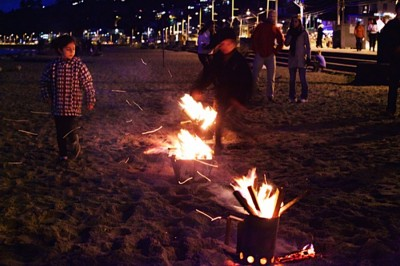 Two children play around Chaharshanbeh Suri bonfires, a Nowruz opening ceremony the author grew up with. (Photo by Lucinda Homa Gray)