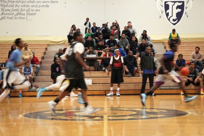 A game between Team Shafi and Team Al-Huda in the Companion Athletics basketball league at Foster High School in Tukwila last Sunday. The all East African basketball league started last year and now involves about 180 players. Players are required to keep their grades above a C average to participate. (Photo by Alex Stonehill)