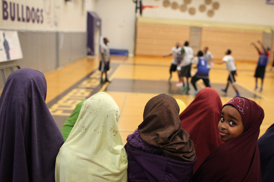 Naima Abdi, 6, sits in the women's section with parents and siblings of players. The organization also has a smaller program for girls held at the SeaTac Community Center. (Photo by Alex Stonehill)