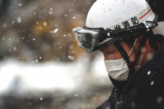 A member of a Japanese Search and Rescue team, still looking for survivors in Unosumai, Japan six days after the earthquake. (Photo by Master Sgt. Jeremy Lock via Flickr)
