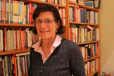 In her office, Dr. Jody McVittie stands before her books on parenting