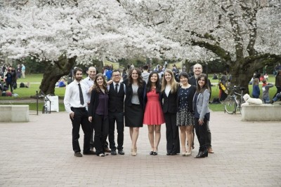 Task Force students pose under the cherry blossoms at the University of Washington prior to presenting their videos and reports to Francisco Altschul, Salvadoran Ambassador to the U.S. (Photo by Alex Montalvo)