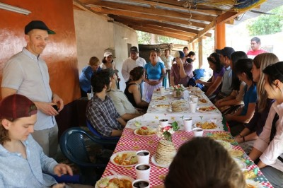 Task force students enjoy a lunch of homemade tortillas, chicken, rice, and salad at a survivor's home prior to hearing her testimony. (Photo Courtesy of Unfinished Sentences)