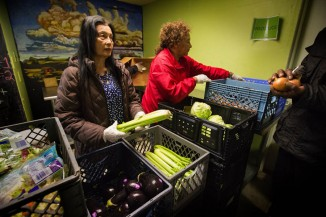 "Rainier Valley Food Bank volunteers used the Japanese Kaizen philosophy to resolve food-bank ""choke points."" (Ellen M. Banner/The Seattle Times)"