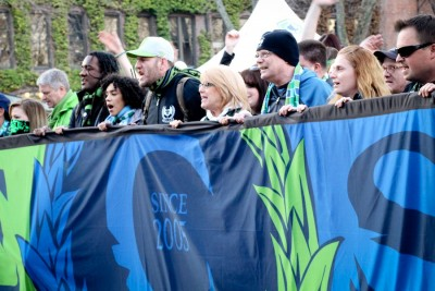 """Emerald City Supporters lead the """"March to the Match"""" from Pioneer Square to CenturyLink Field at last Sunday's home opener. (Photo by Justice Magraw)"""