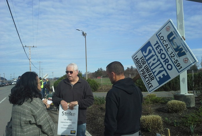 Katrina Pestano (far left) talks to a United Steel Workers Tesoro striker along March Point Road in front of the Anacortes Tesoro oil refinery responsible for the deaths of seven workers in 2010.