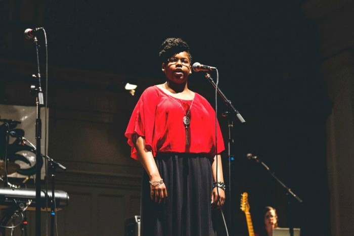 Carlynn Newhouse participates in the Youth Speaks Seattle Grand Slam Competition in April. (Photo by Travis Thompson.)
