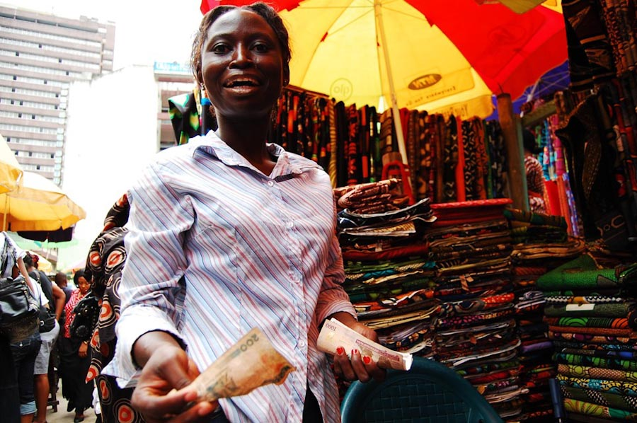 A vendor in the famous Ankara alley of Balogun Market in Lagos. (Photo by Lola Akinmade)